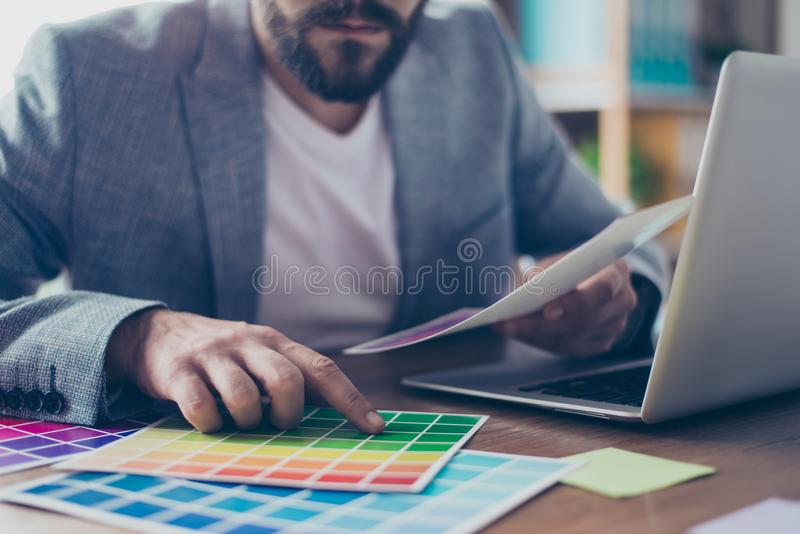 Close up cropped shot of hand of male graphic designer, interior royalty free stock image