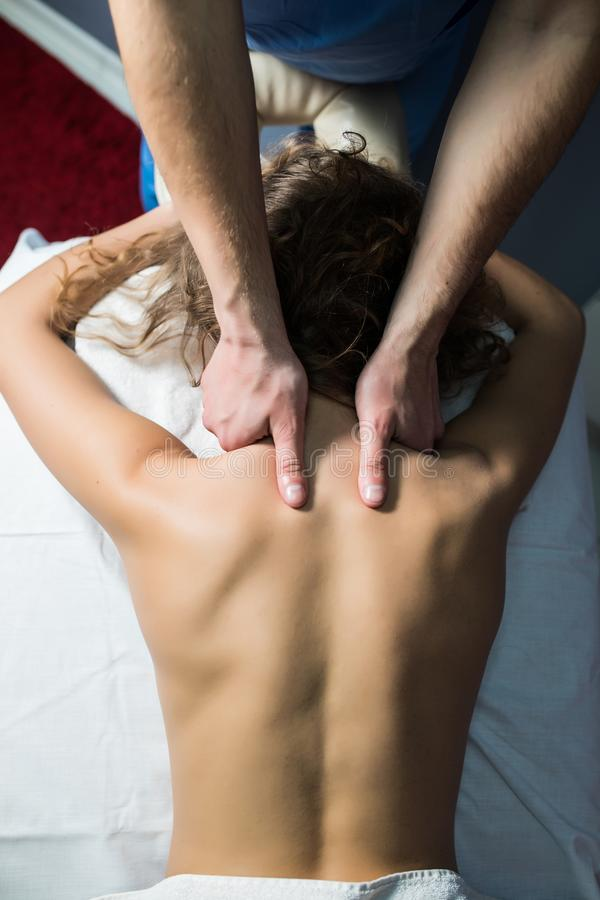 Close up cropped shot of a professional masseuse working massaging back of a woman relaxation pampering treatment beauty health li stock photography