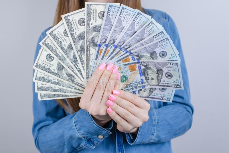 Close-up cropped view photo of pretty wearing casual outfit she her lady holding big pile of money in hands  grey. Background stock photos