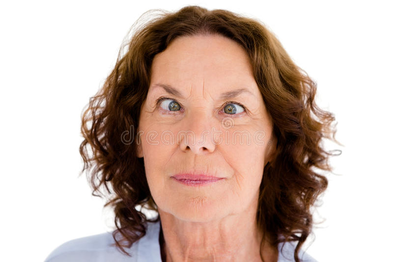 Close-up of cross-eyed woman. Against white background stock photos