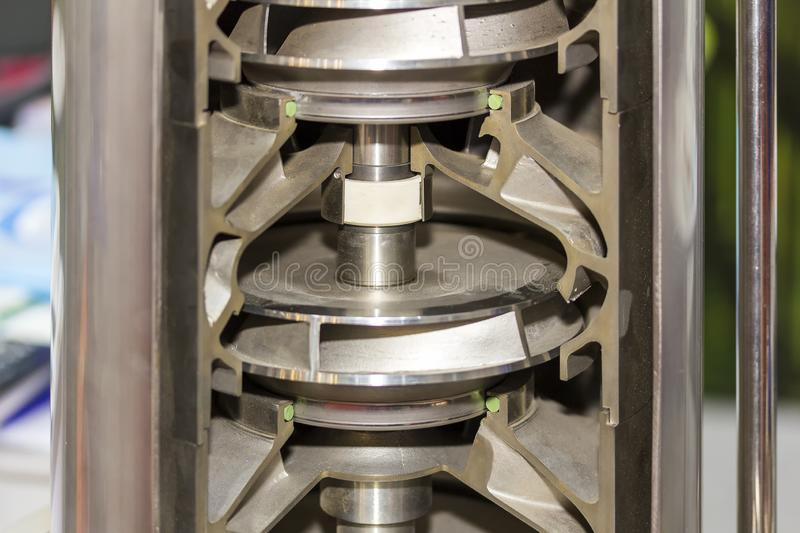 Close up cross section detail impeller and inside centrifugal multistage ring vertical pump for industrial.  royalty free stock photos