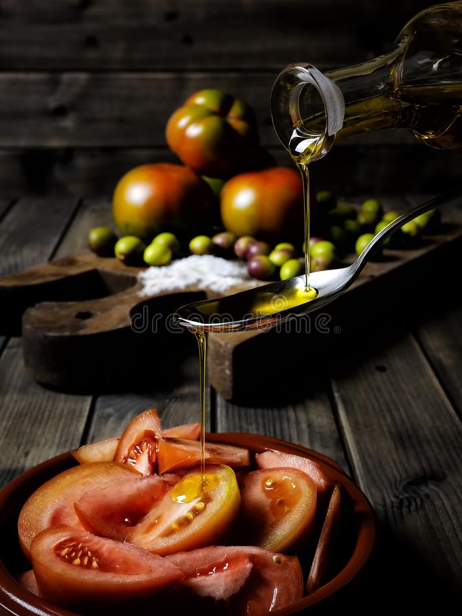 Tomato salad dressed with extra virgin olive oil royalty free stock photo