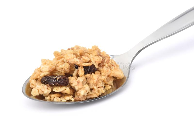 Crunchy oat granola cereal with dried fruits in stainless spoon stock photo