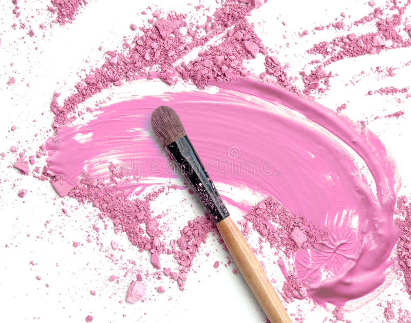 Close up of crushed blush on white background and cosmetic foundation beige royalty free stock photo