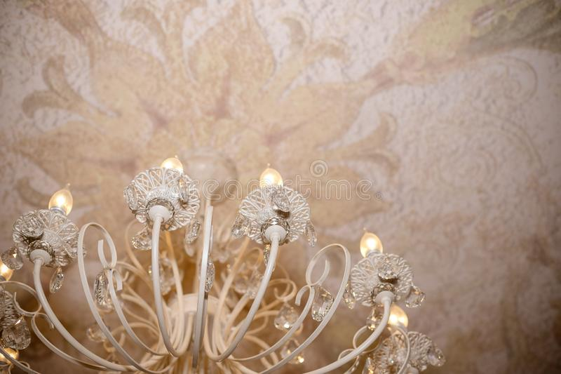 Close up on crystal of contemporary chandelier, is a branched ornamental light fixture designed to be mounted on royalty free stock photos