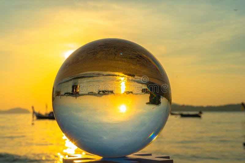 close up crystal glass ball put on the beach royalty free stock photography