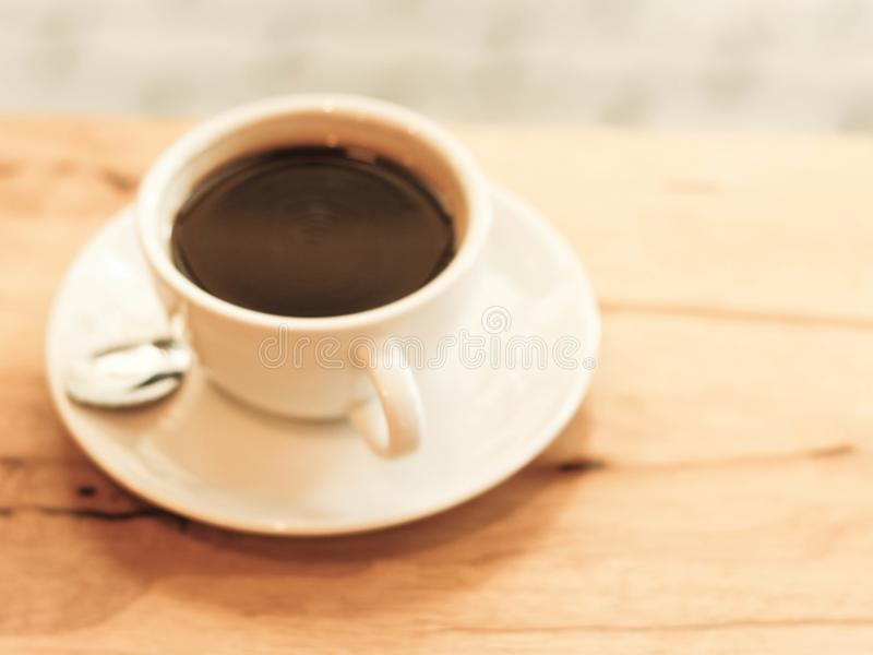 Cup of black coffee on wood table stock photography