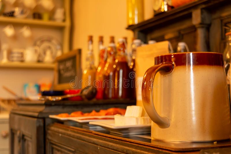 Close Up of Cup and Bottles of Marmelade for Breackfast in English Cottage in Countryside. On Blurred Background, autumn, breakfast, calm, coffee, cold, drink royalty free stock images