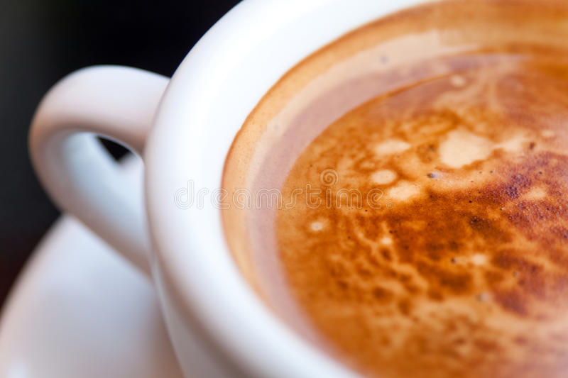 Close-up of a cup of coffee royalty free stock image