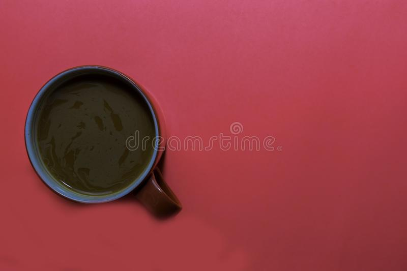Close up cup of coffee isolated on pink background royalty free stock image