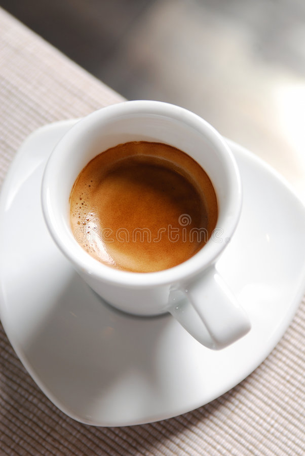 Close-up of a cup of hot coffee royalty free stock images