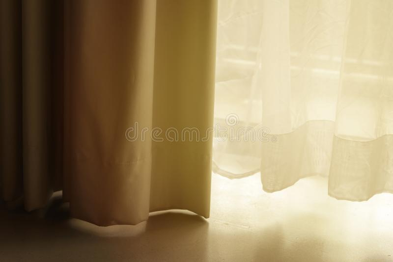 Curtain with white sheer curtains. draperies at a window royalty free stock photo