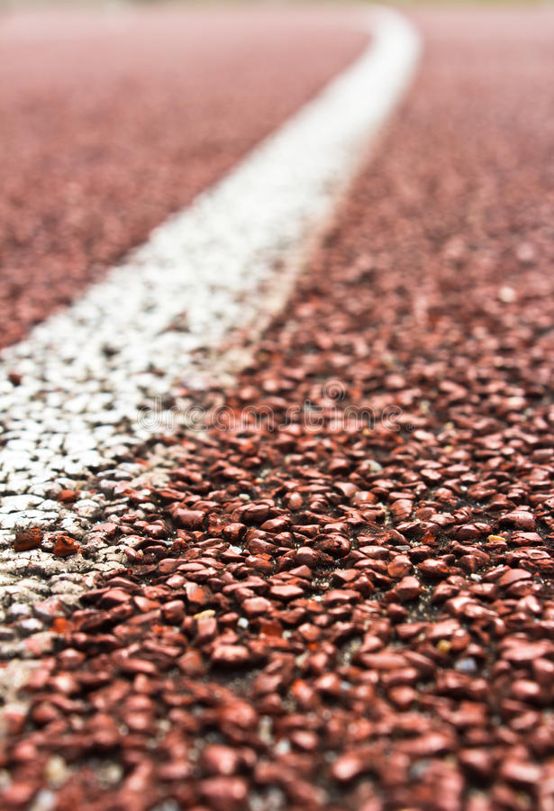Close up curve of running track. Rubber standard red color royalty free stock photography