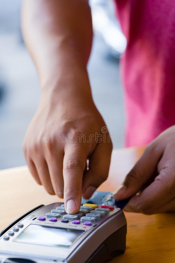 close up customer hand holding and paying for order by credit card in cafe and restaurant.credit card payment service.custumer or stock photos