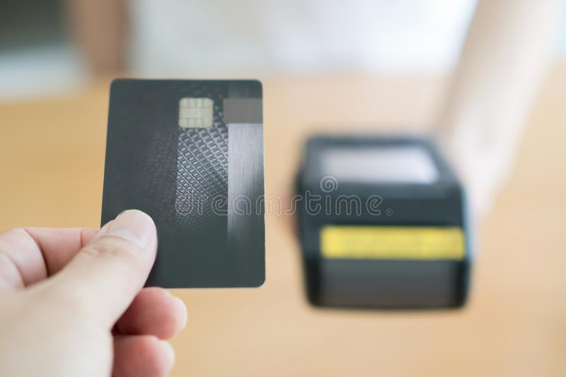 Close up of customer paying by credit card. Isoleat stock photography