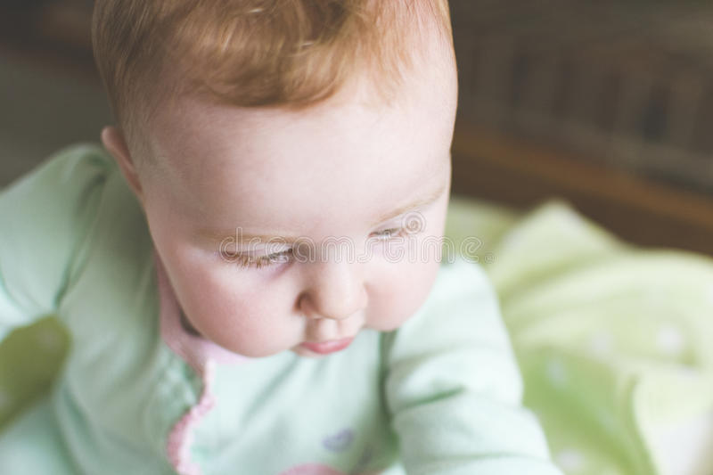 Close-up of cute baby in crib royalty free stock photos