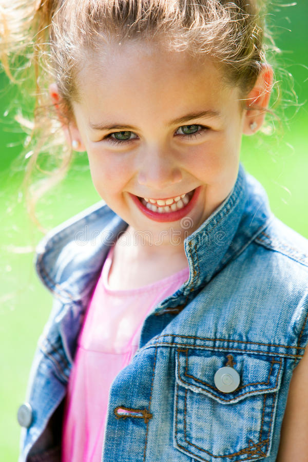 Close up of cute girl with happy smile. royalty free stock image