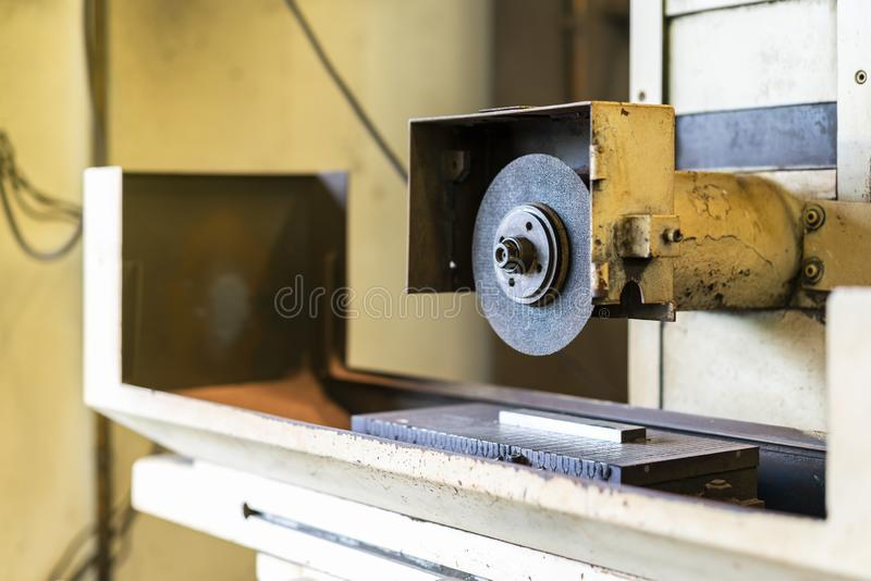 Close up cutting or grinding wheel of high accuracy surface horizontal grinding machine for finishing process in industrial metal royalty free stock images