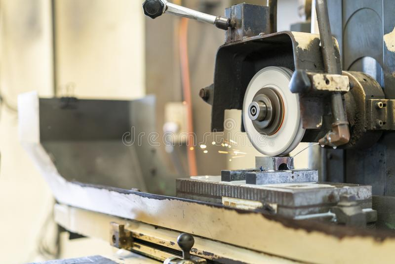 Close up cutting or grinding wheel during rotating or working with product on high accuracy and automatic surface horizontal stock photo