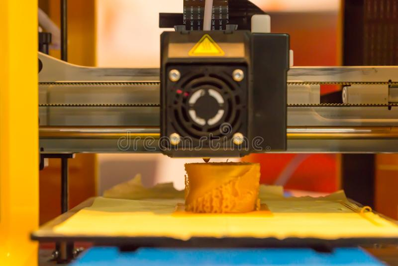 3d printing machine printing a piece of plastic. Close up of 3d printing machine printing a piece of plastic royalty free stock images