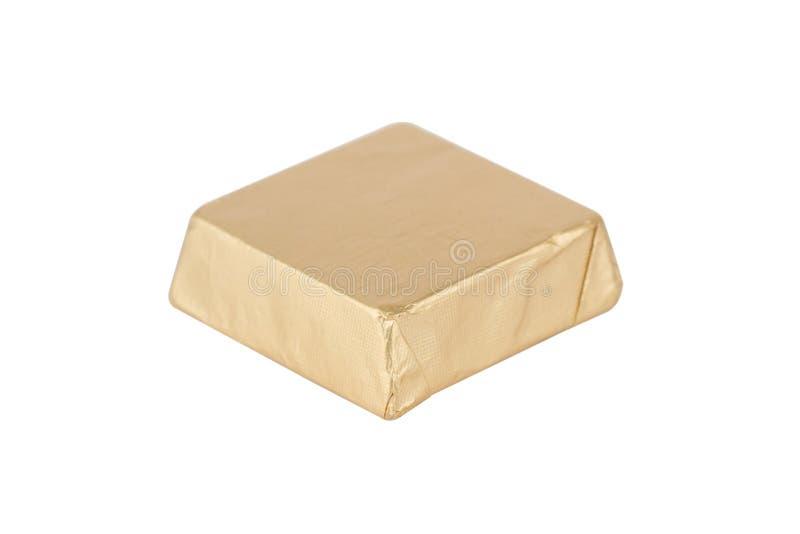 Close up da barra de chocolate no empacotamento dourado imagens de stock royalty free