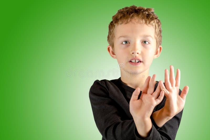 Close up da expressão muito calma nova do menino imagens de stock royalty free