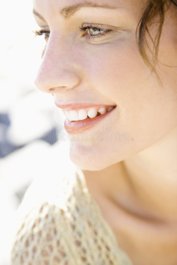 Close-up da face de sorriso da mulher. foto de stock royalty free