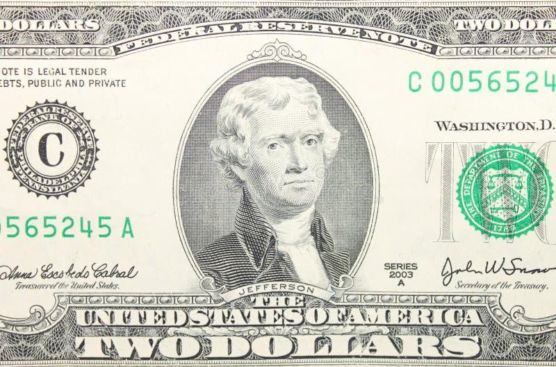 Close up da nota de dólar do americano dois fotografia de stock