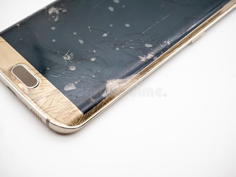Close-up of damaged smartphone display with white background royalty free stock photography