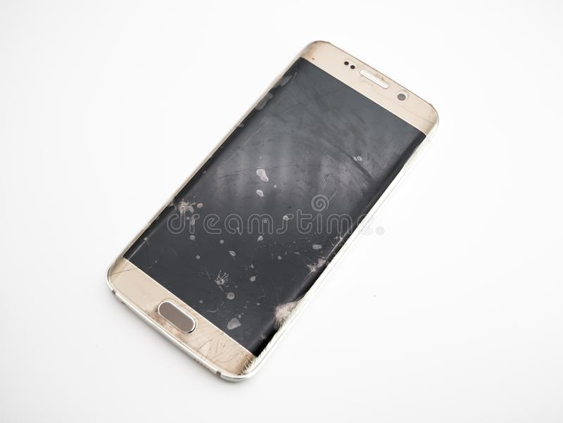 Close-up of damaged smartphone display with white background royalty free stock image
