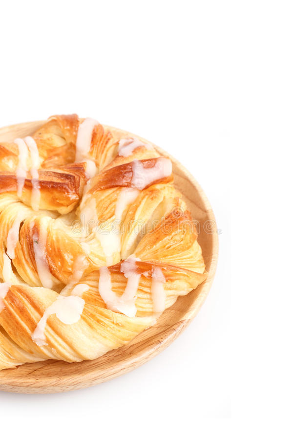 Close up Danish pastries on wooden dish isolated on white royalty free stock image