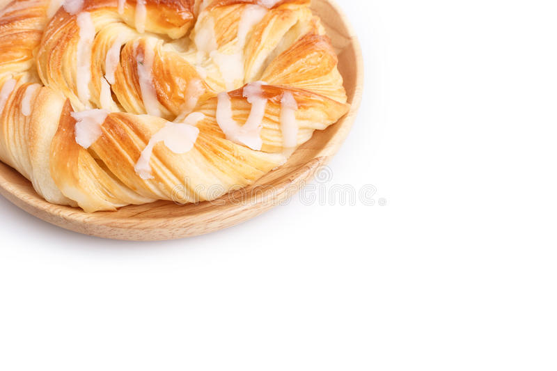 Close up Danish pastries on wooden dish on white stock photography
