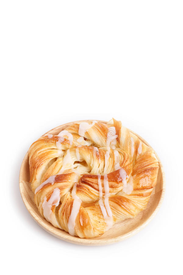 Close up Danish pastries on wooden dish on white stock photos