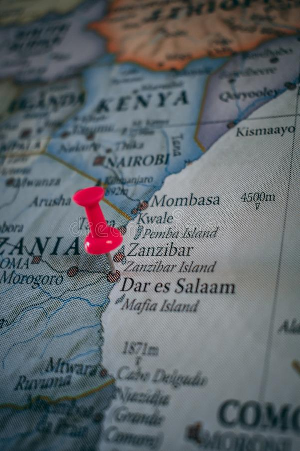 Close up of Dar es Salaam pin pointed on the world map with a pink pushpin royalty free stock photography