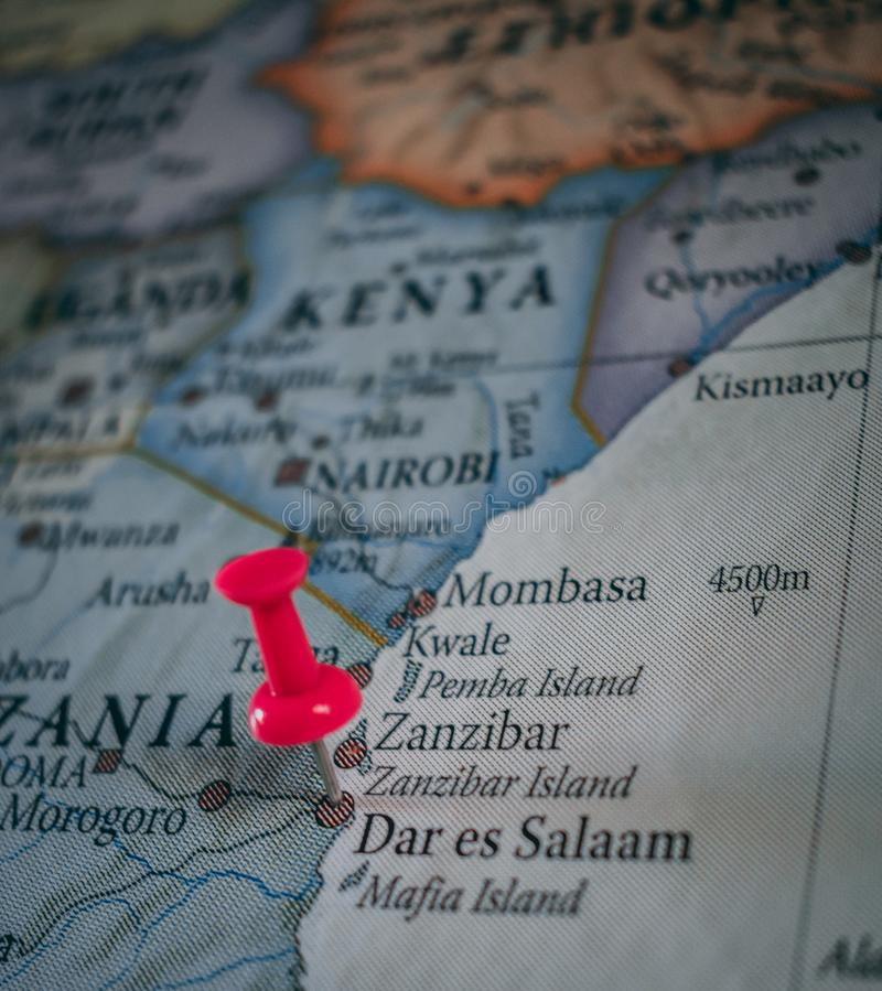 Close up of Dar es Salaam pin pointed on the world map with a pink pushpin royalty free stock photo