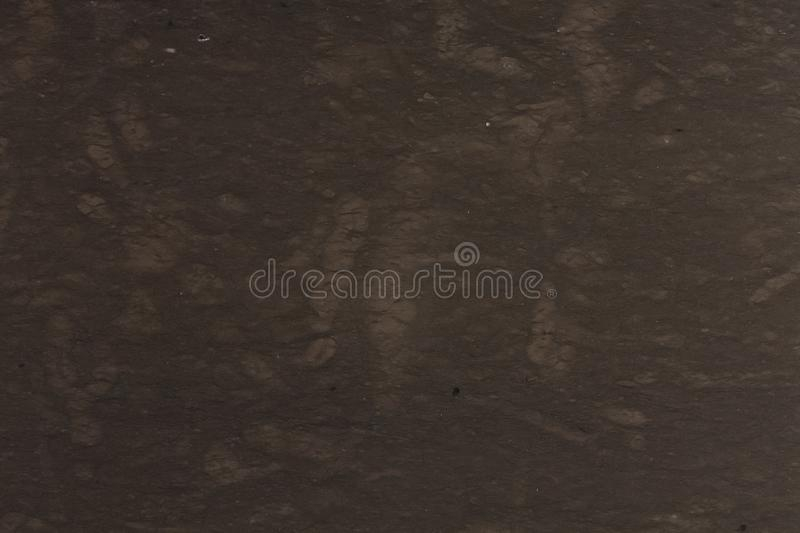 Close up of dark brown marble texture background. royalty free stock photography