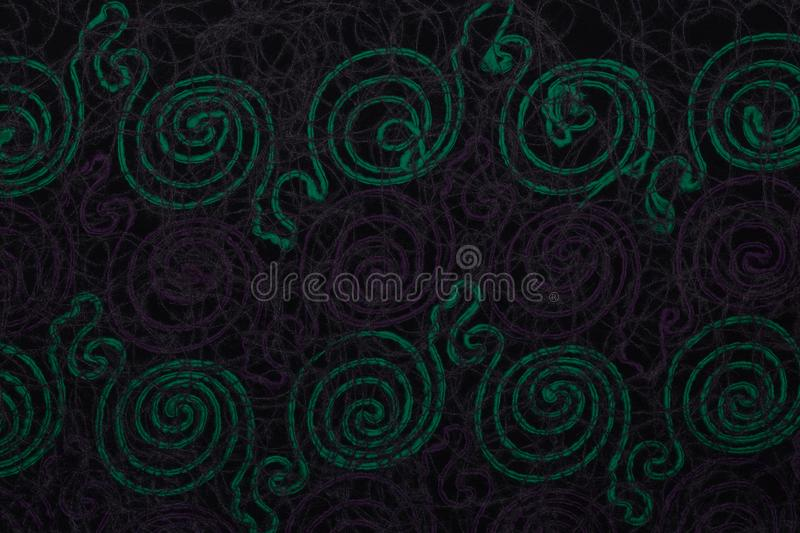Close up of dark fabric with green and violet patterns with textile texture background stock image