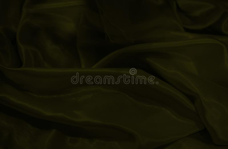 Close up on dark yellow material background or texture stock images