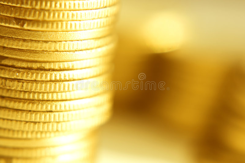 Close-up das moedas de ouro fotografia de stock royalty free