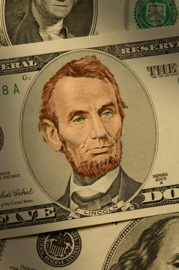 Close-up de Abraham Lincoln na conta $5 fotografia de stock royalty free