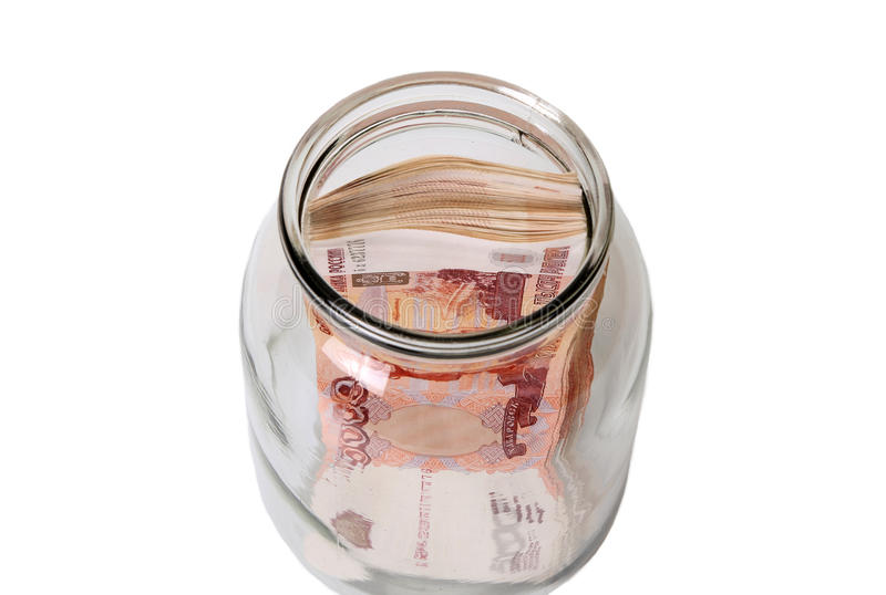 Close-up de cédulas do russo em um frasco de vidro imagem de stock royalty free