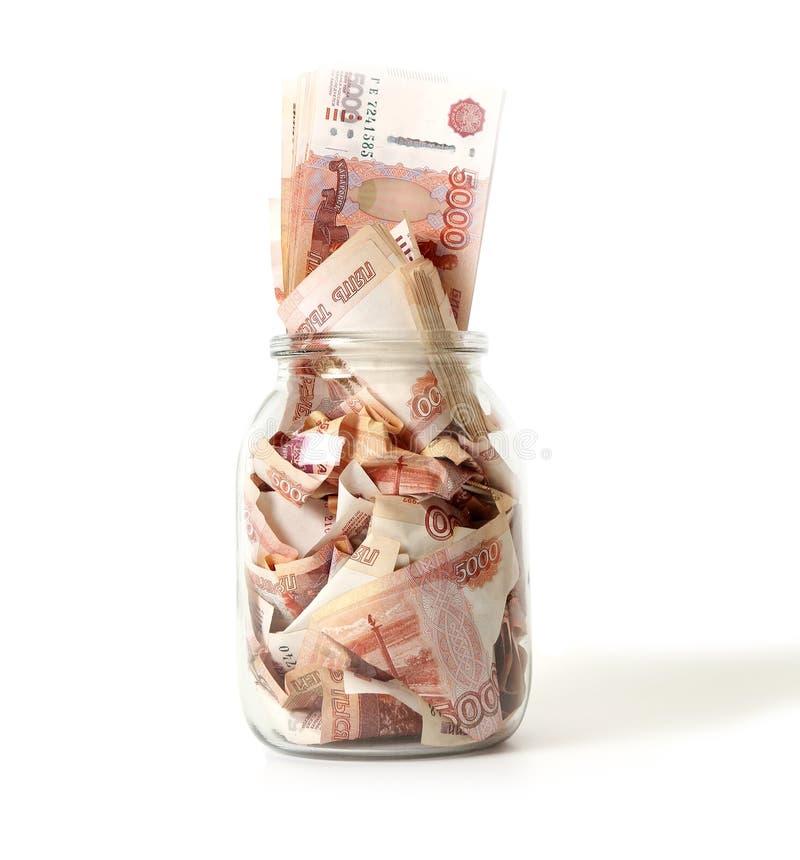 Close-up de cédulas do russo em um frasco de vidro foto de stock royalty free