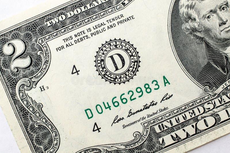 Close up de duas notas de dólar imagens de stock royalty free