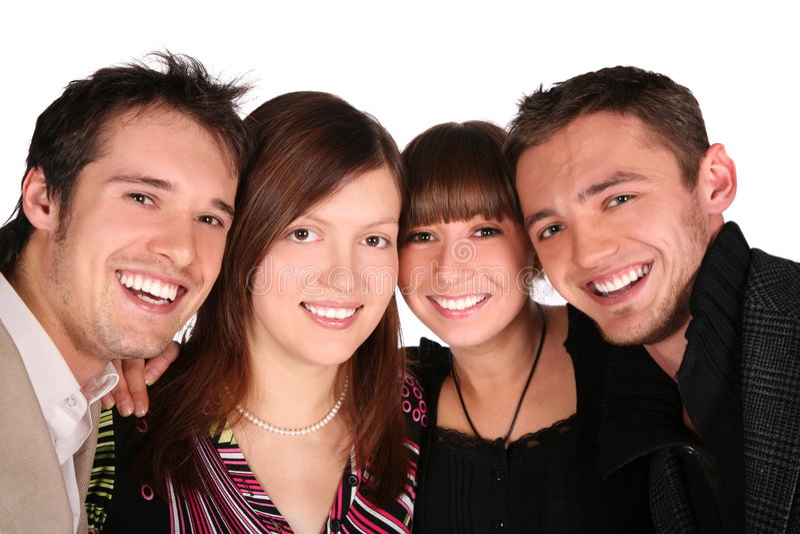 Close-up de quatro faces dos amigos fotografia de stock royalty free
