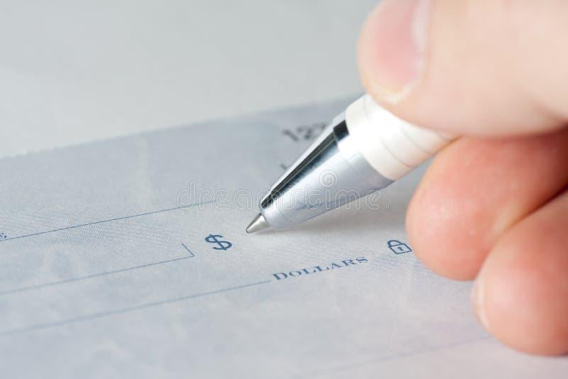 Close up de um cheque imagens de stock royalty free