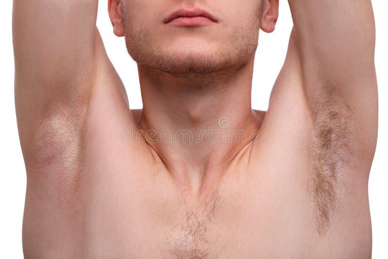 Close-up de um homem que mostra uma axila isolada em um fundo branco fotografia de stock