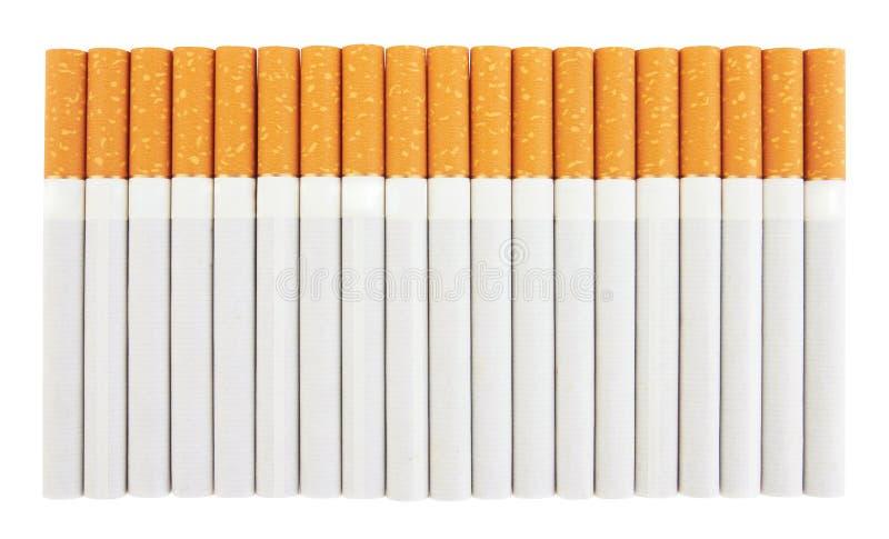 Close up de uma pilha dos cigarros imagens de stock