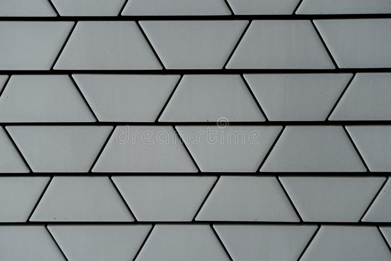 Close-up of decorative ceramic white brick wall in trapezoid pat stock photo