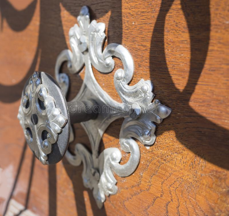 Close up decorative old metal fitting on ancient medieval brown wooden door stock images