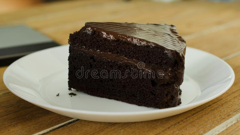 Close up of delicious Chocolate cake dessert on wood table backgrounds stock image